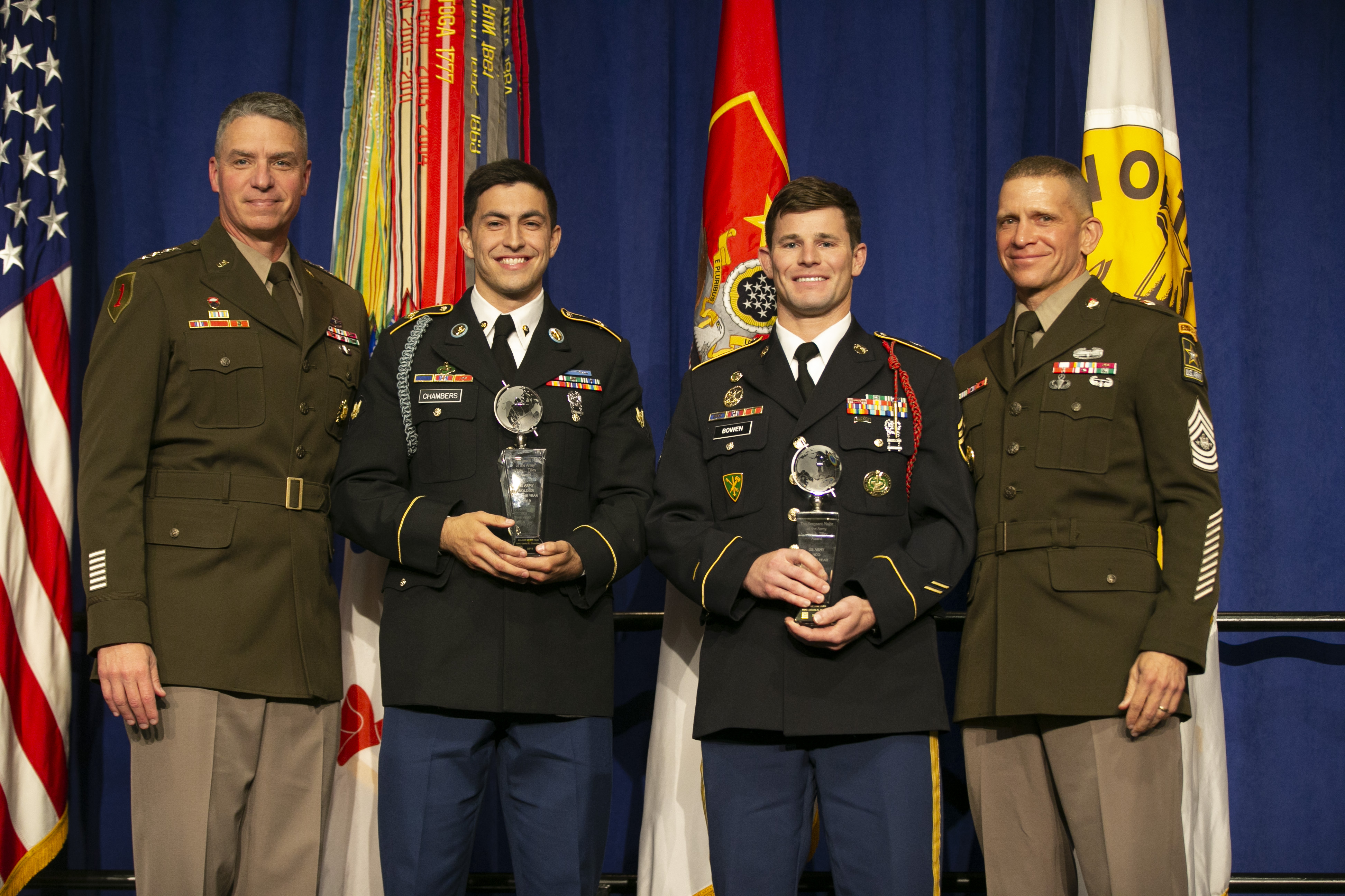 Army Vice Chief of Staff Gen. Joseph Martin, left, and Sgt. Maj. of the Army Michael Grinston, right, stand with the 2019 Soldier of the Year Spc. David Chambers, second from left, and the Noncommissioned Officer of the Year Staff Sgt. Dakota Bowen.