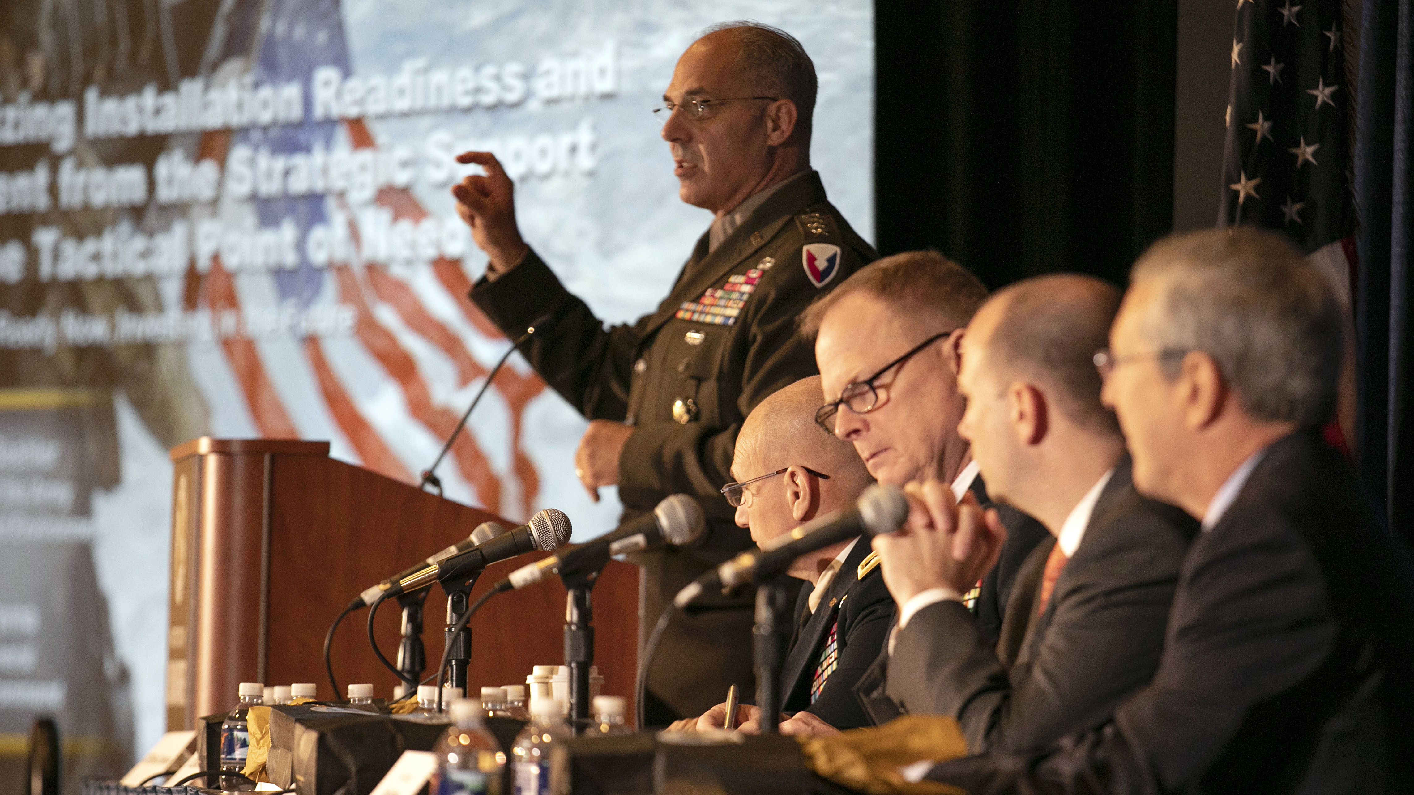 General Gustave Perna leads the ILW Forum panel discussion on Installation Readiness at the 2019 AUSA Annual Meeting and Exposition at the Washington Convention Center on Oct. 15, 2019.