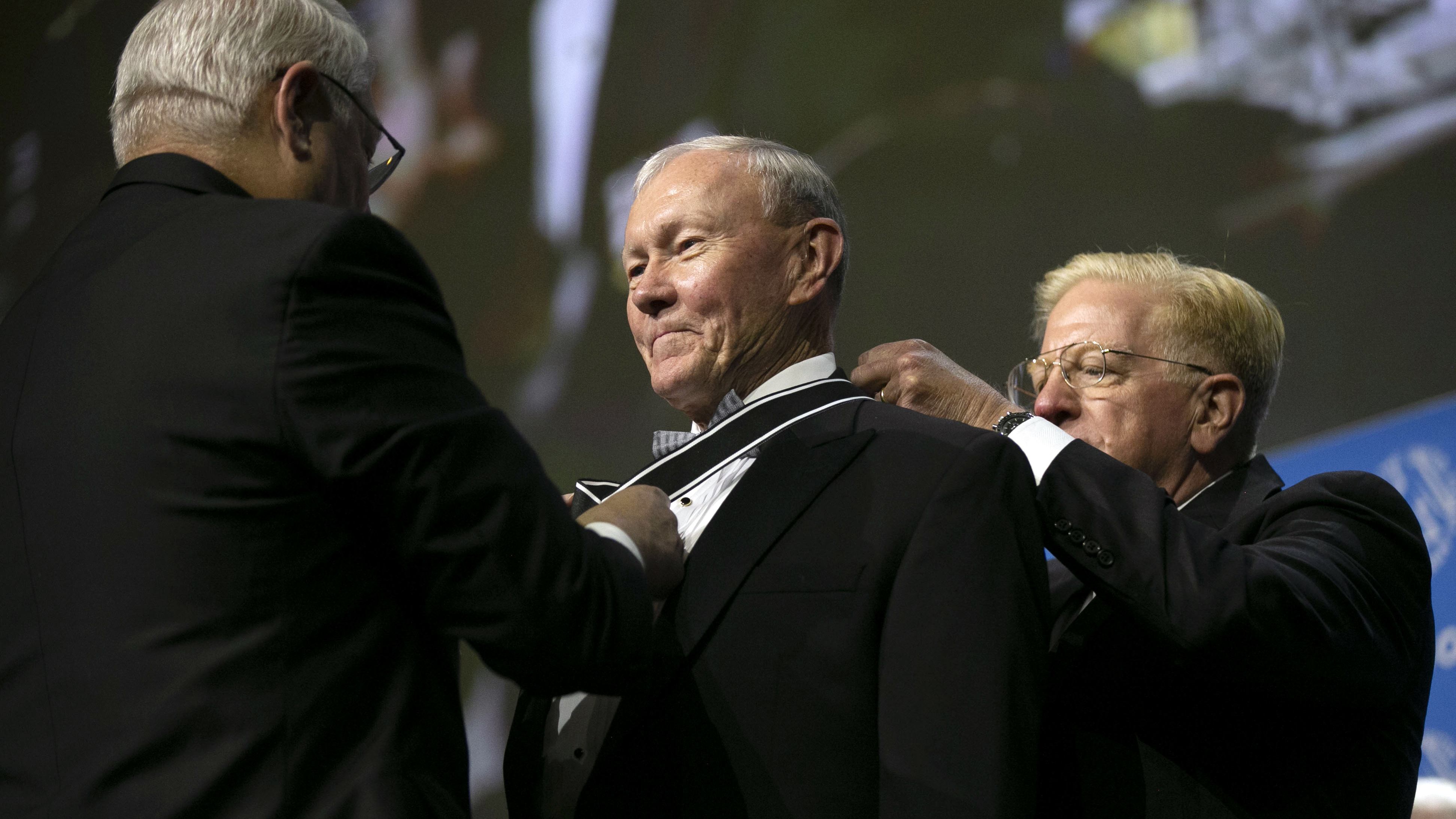 Gen. Martin Dempsey is presented with the George Catlett Marshall Medal by AUSA President Gen. Carter Ham, left, and AUSA Trustee Rudy de Leon during closing ceremonies at the 2019 AUSA Annual Meeting and Exposition at the Washington Convention Center on