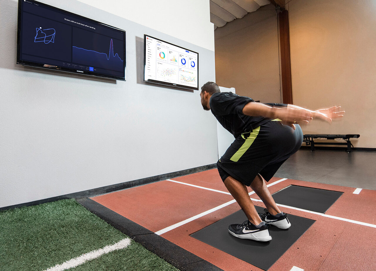 An athlete performs a Jump Scan on the Sparta Force Plate; one of the scans used to provide individualized training to athletes and warfighters with the help of Sparta Science's Force Plate Machine Learning™.