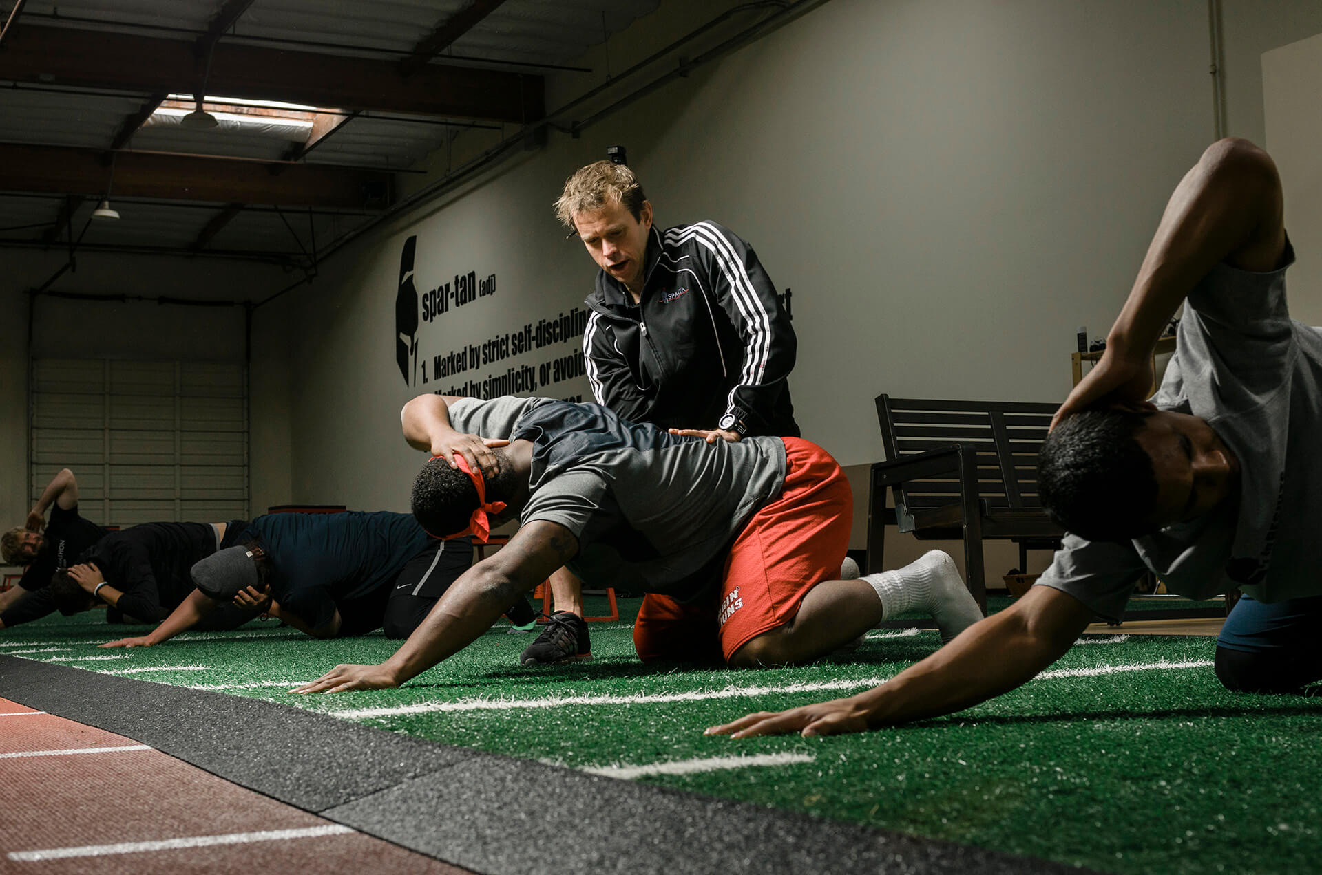 Dr. Phil Wagner, MD, working with professional athletes in Sparta Science's California training facility.