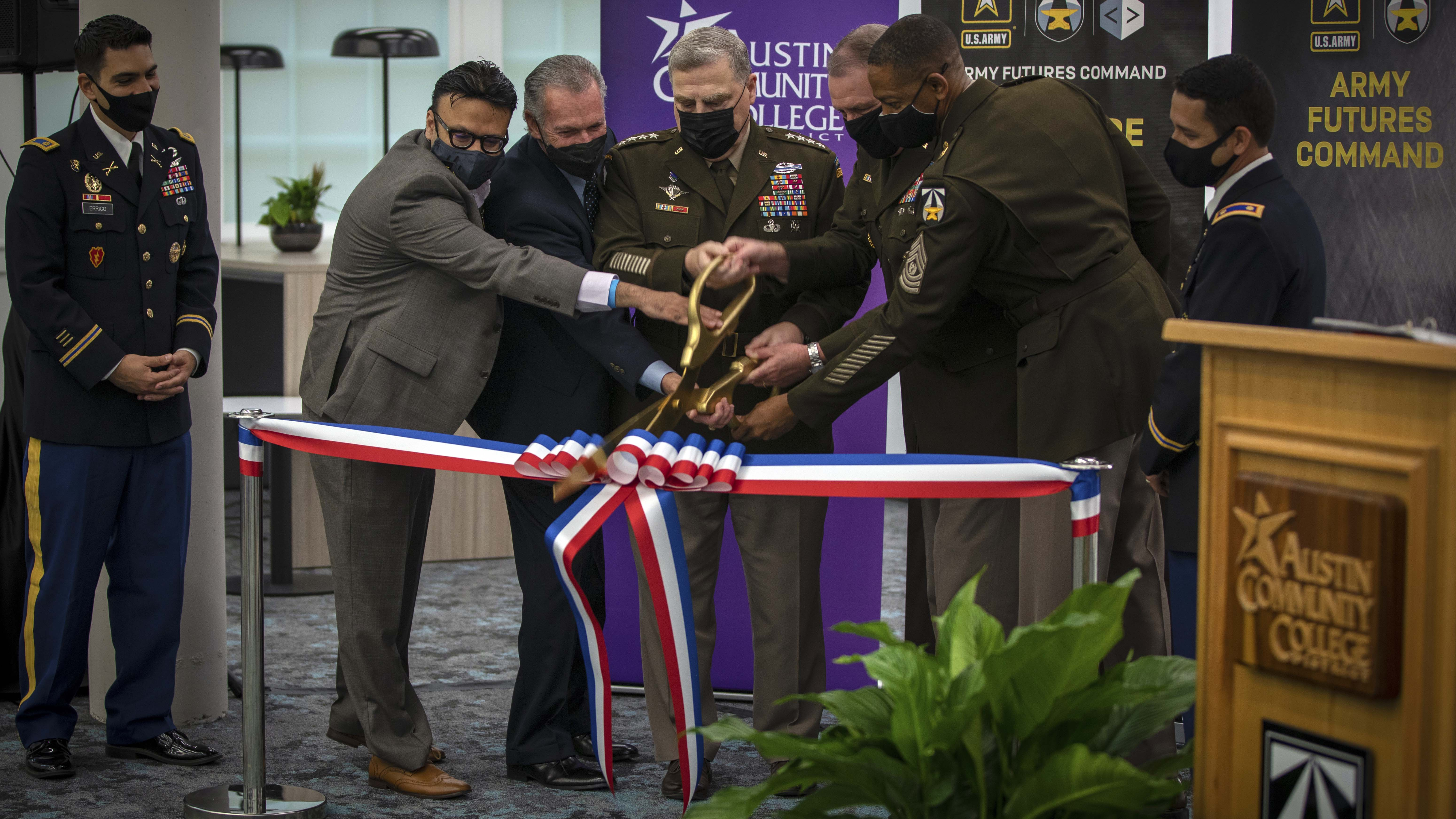 Soldiers cutting a ribbon