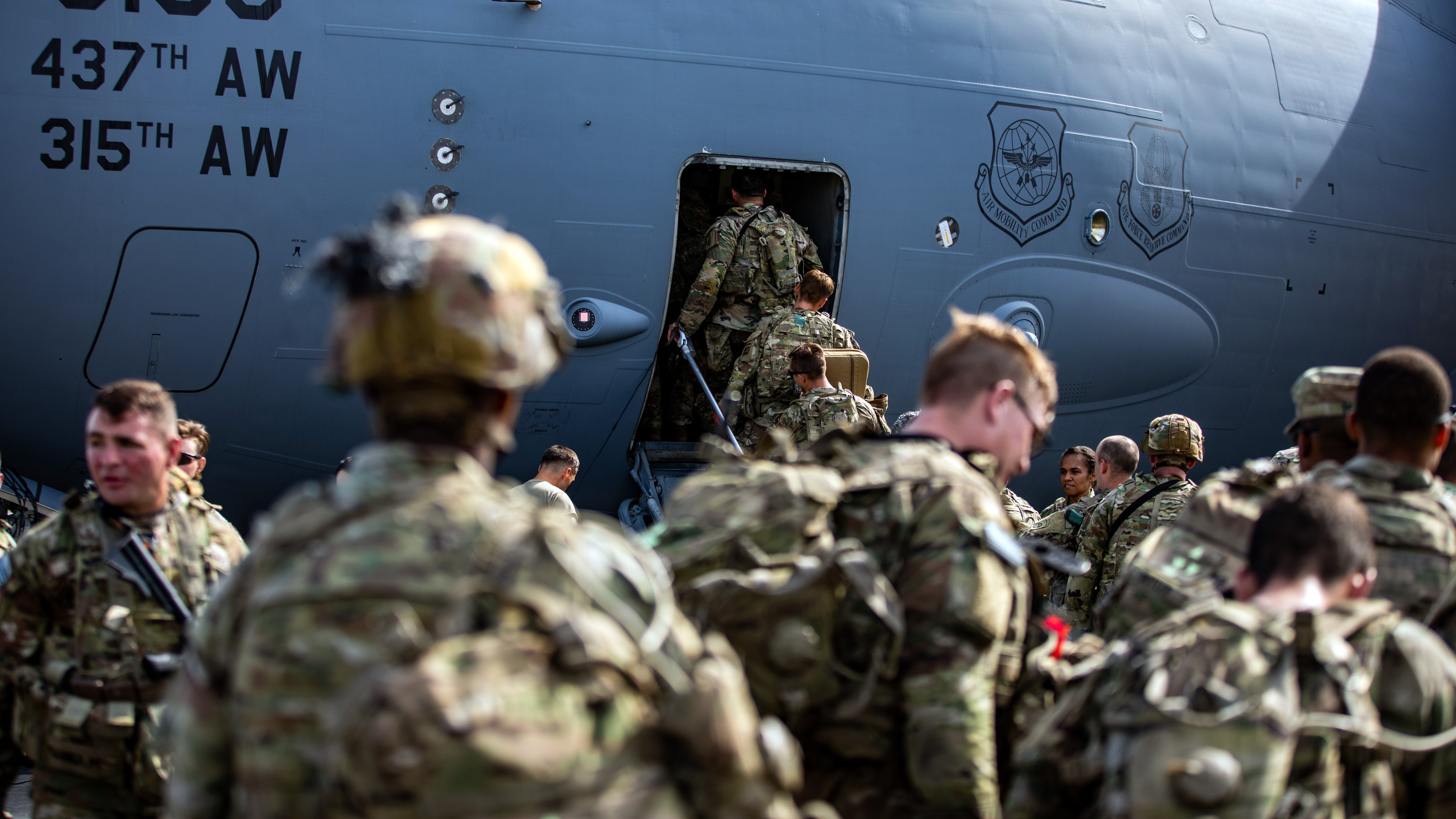 Soldiers boarding airplane