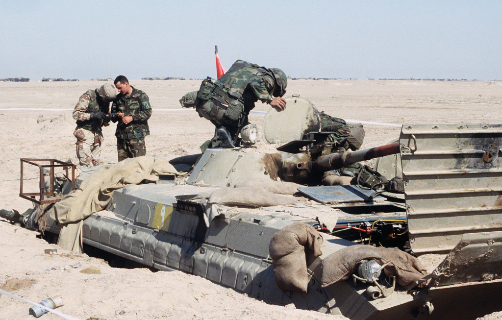 military police with the 1st armored division vii corps inspect an iraqi republican guard infantry fighting vehicle that was damaged during operation
