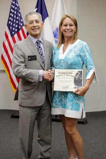 Chapter President, MSG (Ret) Soto presents Community Partner Certificate to Ms. Katherine Kage