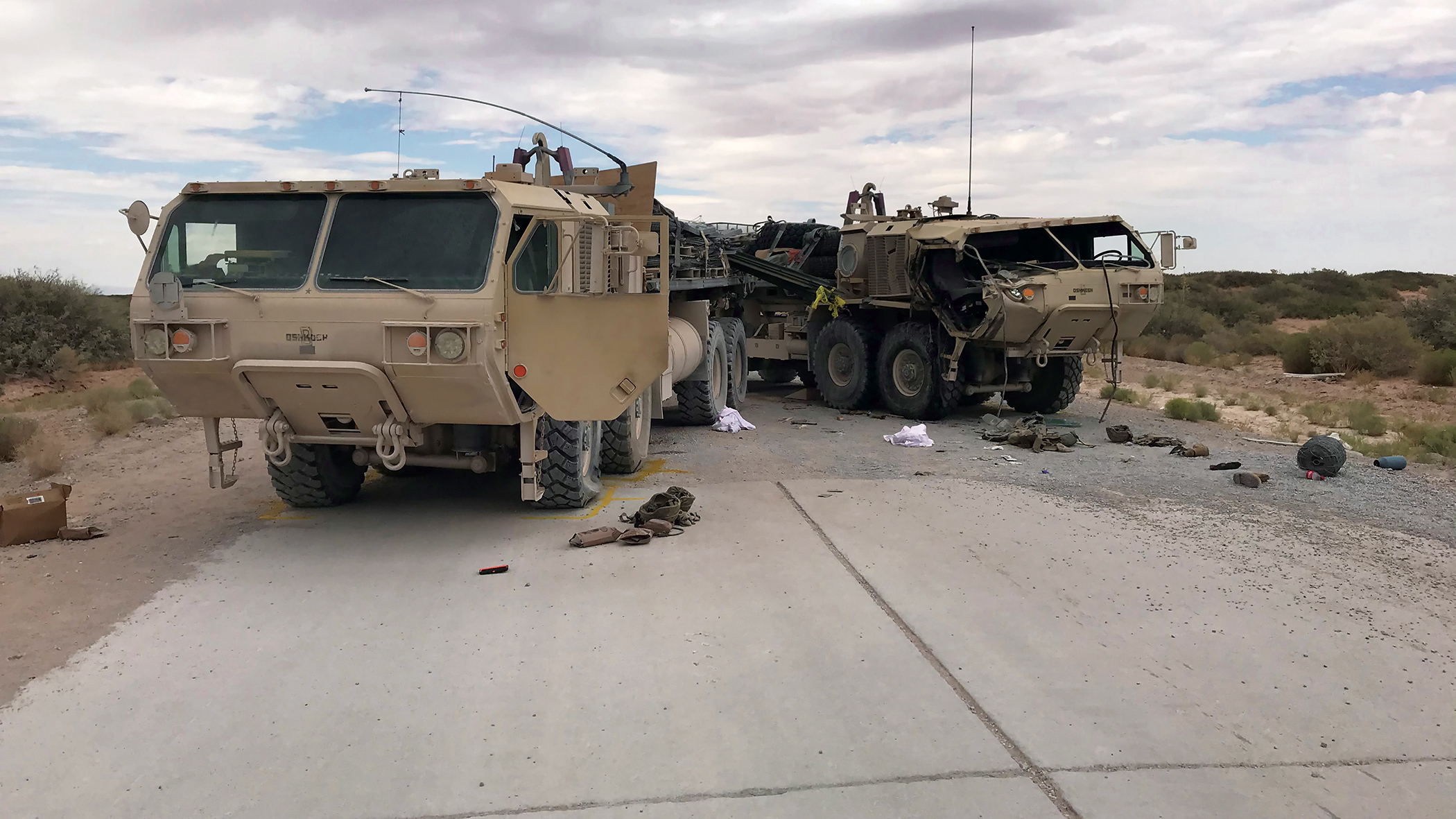 Two heavily damaged M1120A4 trucks
