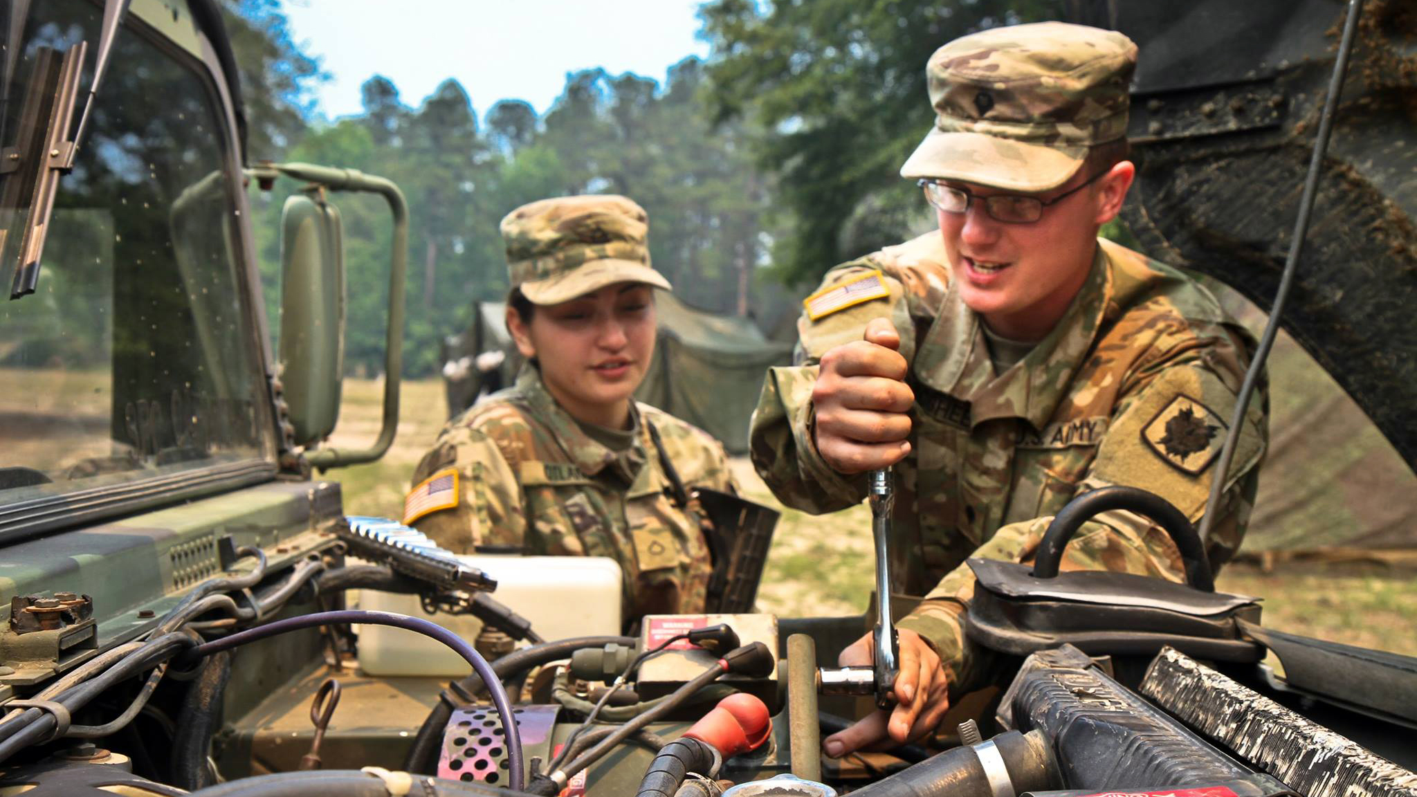 Soldiers maintaining equipment