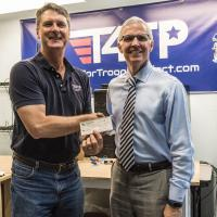 Mike Flanagan, Chapter President, welcomes new Corporate member Mark Casper, Tech4Troops