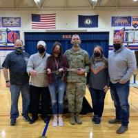 PCHS Coach Worley, AUSA Rep Frank Cannavo, Layla Blevins, SFC Armentrout, Layla's parents Jessica and Chris Blevins